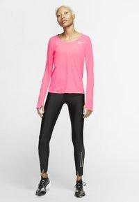 Nike Performance - CITY SLEEK - Camiseta de deporte - digital pink - 1