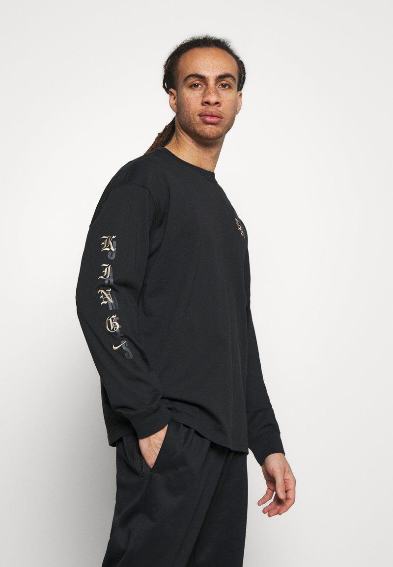 Nike Performance - T-shirt med print - black