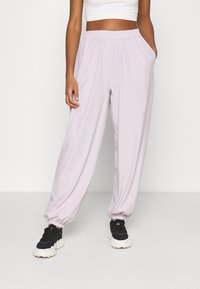 NA-KD - NA-KD X ZALANDO EXCLUSIVE - SPORTY FABRIC PANTS - Tracksuit bottoms - lilac - 0