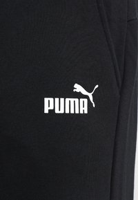 Puma - ESS LOGO PANTS  - Tracksuit bottoms - puma black - 5