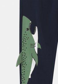 Lindex - PLACED SHARK - Tracksuit bottoms - dark navy - 2