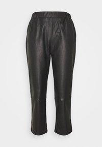 PCSALIMA CROPPED PANTS - Trousers - black