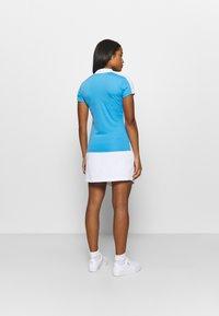 J.LINDEBERG - NOUR GOLF - Koszulka sportowa - ocean blue - 2