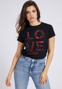 Guess - T-shirt imprimé - schwarz - 0