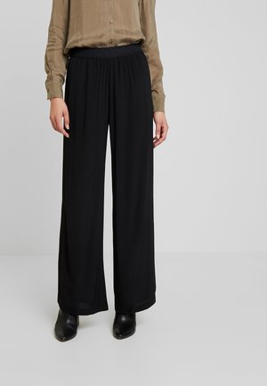 NESSIE  - Trousers - black