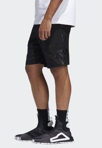 adidas Performance - N3XT L3V3L SHORTS - Sports shorts - black - 3