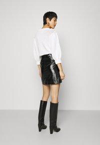 Calvin Klein Jeans - HIGH SHINE MINI SKIRT - A-line skirt - black - 2