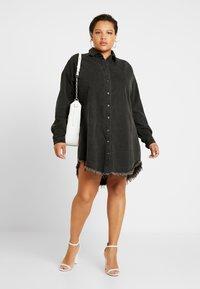 Missguided Plus - OVERSIZED FRAY HEM DRESS - Denim dress - black - 2