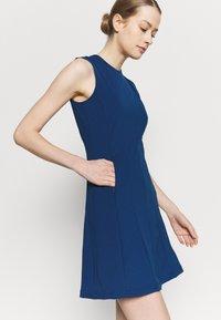 J.LINDEBERG - JASMIN GOLF DRESS 2-IN-1 - Sports dress - midnight blue - 3
