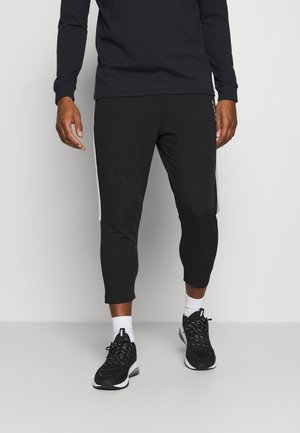 BE ONE - Tracksuit bottoms - nero