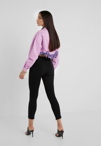 Versace Jeans Couture - Leggings - black - 2
