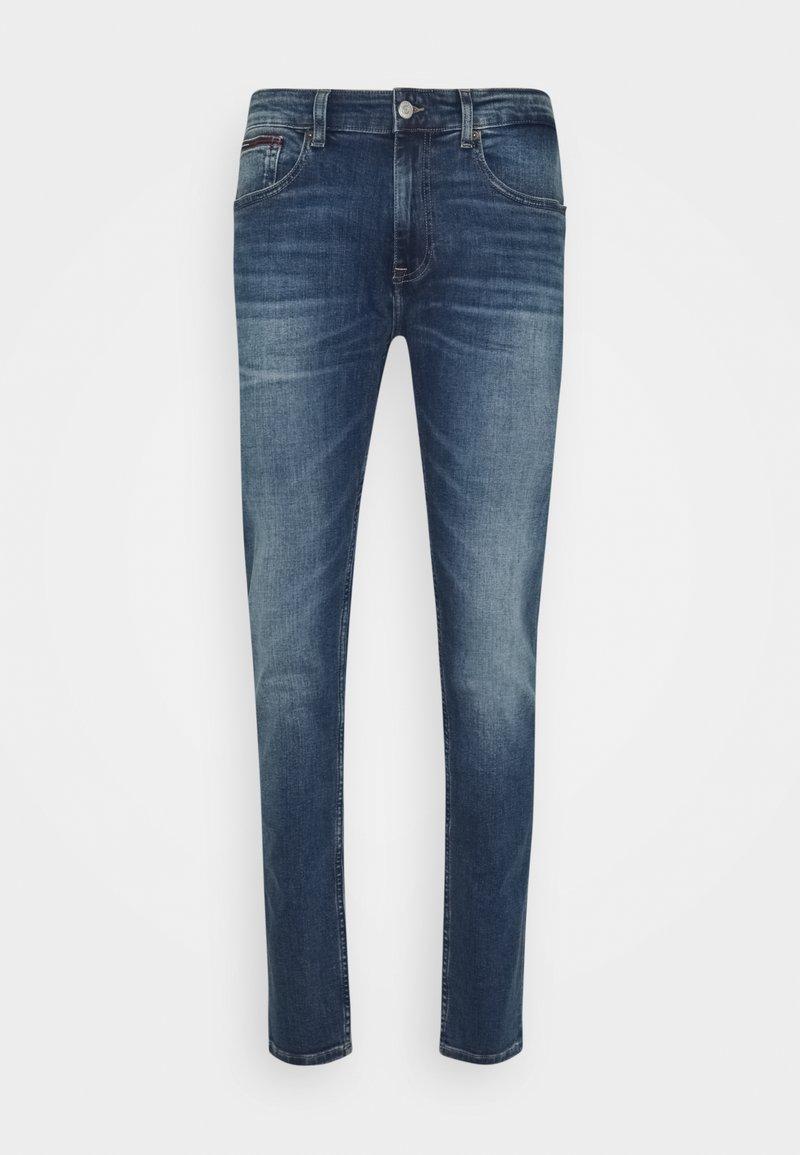 Tommy Jeans - AUSTIN SLIM TAPERED - Slim fit jeans - denim medium