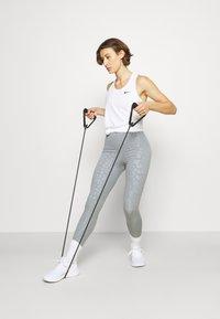 Nike Performance - TANK - Sports shirt - white/black - 1