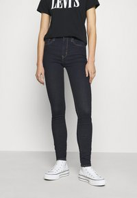 Levi's® - 721™ HIGH RISE SKINNY - Jeansy Skinny Fit - rinsed denim - 0