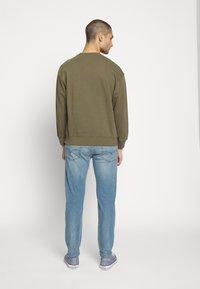 Levi's® - 502™ TAPER HI BALL - Jeans Tapered Fit - blue denim - 2