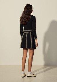 sandro - EUDINE - Mini skirt - noir - 2