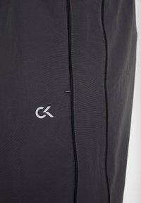 Calvin Klein Performance - TRACK PANTS - Spodnie treningowe - gunmetal/black - 6