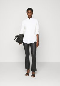 Object Tall - OBJBELLE COATED - Bootcut jeans - black - 1