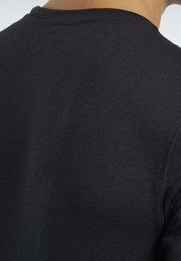 Reebok - T-shirts basic - black - 4