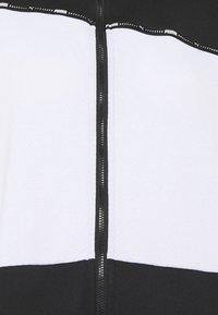 Puma - TRAIN LOGO ULTRA JACKET - Training jacket - black/white - 6