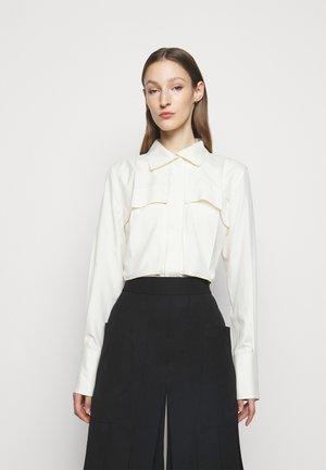 FUNNEL NECK  - Button-down blouse - off white