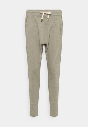 JUNGLE - Tracksuit bottoms - covert green