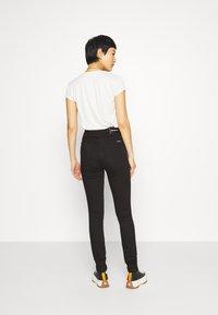 Calvin Klein Jeans - HIGH RISE  - Skinny džíny - eternal black - 2