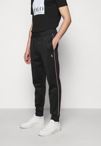 Polo Ralph Lauren - LUX TRACK - Tracksuit bottoms - black - 0