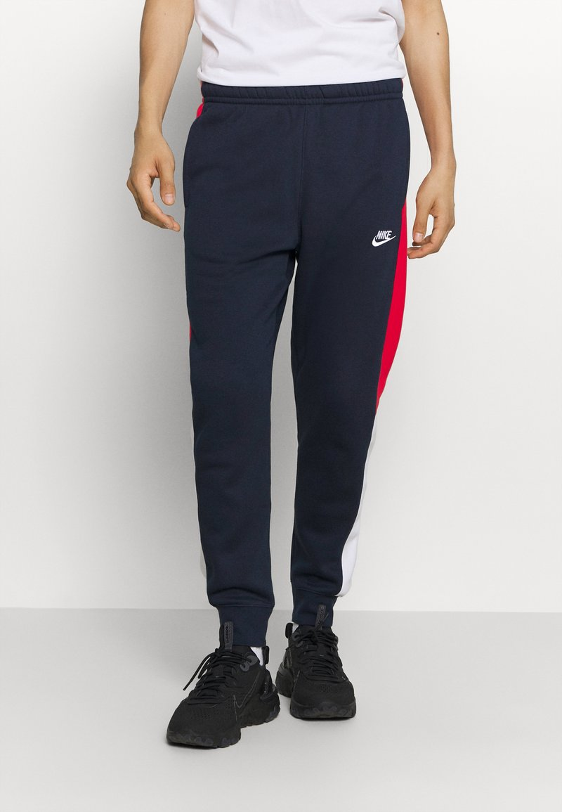 Nike Sportswear - Tracksuit bottoms - obsidian/university red/white