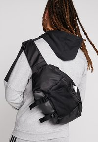 adidas Performance - PARKHOOD  - Across body bag - black/black/white - 1