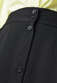 Monki - SIGRID BUTTON SKIRT - A-line skirt - black dark solid - 5
