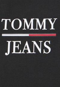 Tommy Jeans - LOGO PEPLUM TEE DRESS - Day dress - black - 5