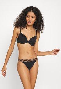 Sloggi - WOMEN SHORE MILI ATOLL TANGA - Bikini bottoms - black - 1