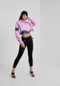 Versace Jeans Couture - Leggings - black - 1