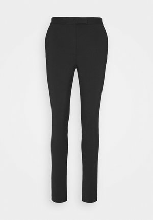 TAIKA - Trousers - black