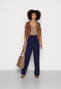 Anna Field - Basic wide leg pants - Trousers - dark blue - 1