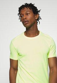 edc by Esprit - NEON DYE - Basic T-shirt - bright yellow - 5