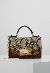 Dorothy Perkins - TOP HANDLE DOUBLE FLAP CROSSBODY SNAKE - Handbag - brown - 0