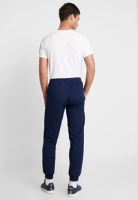 adidas Originals - TRACK BOTTOM - Pantalones deportivos - night indigo - 2