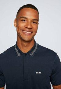 BOSS - PADDY PIXEL - Polo shirt - dark blue - 3