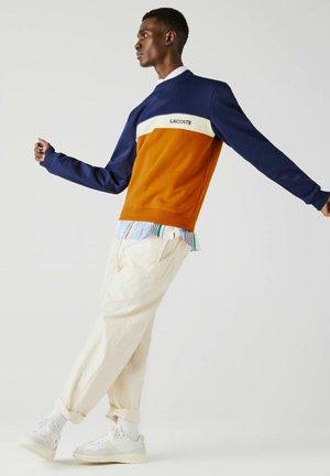Sweatshirt - blau orange beige