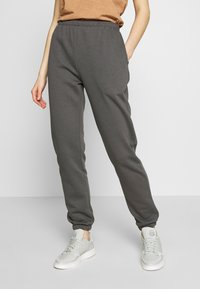 Nly by Nelly - COZY PANTS - Tracksuit bottoms - off black - 0