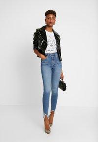 Topshop - JAGGED JAMIE - Jeans Skinny Fit - blue denim - 1