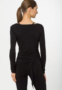 Curare Yogawear - WRAP - Topper langermet - black - 2