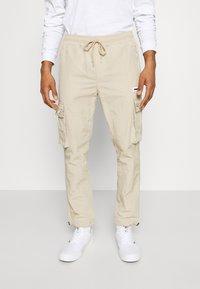 Pegador - AYVO PANTS UNISEX - Cargo trousers - coconut milk - 0