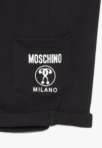 MOSCHINO - Teplákové kalhoty - black - 4
