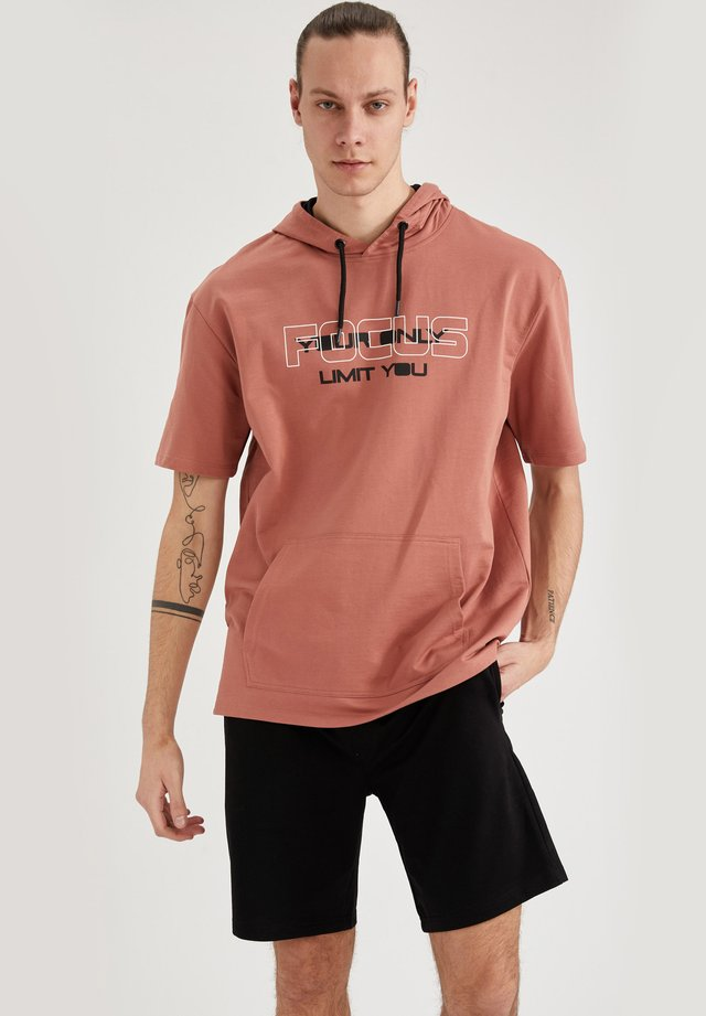 OVERSIZED - T-shirt con stampa - light pink