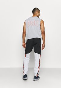 Under Armour - FASHION TRACK PANT - Tracksuit bottoms - grey - 2