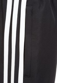 adidas Performance - TIRO 19 WOVEN TRACKSUIT BOTTOMS - Tracksuit bottoms - black / white - 3