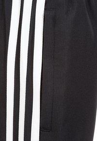 adidas Performance - TIRO 19 WOVEN TRACKSUIT BOTTOMS - Spodnie treningowe - black / white - 3